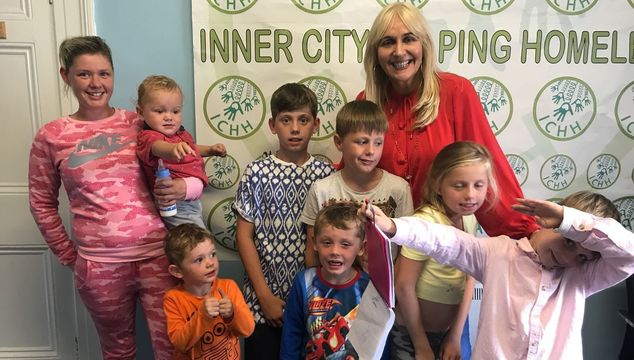 Margaret and her family with broadcaster, Miriam O\'Callaghan
